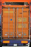 Cargo container. Orange cargo shipping container at lorry trailer Royalty Free Stock Photography