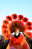 Orange carnival costume and mask Royalty Free Stock Photography