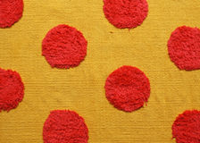 Orange carpet. With red dots Stock Images