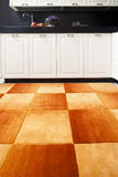 orange carpet in the black and white kitchen Royalty Free Stock Image