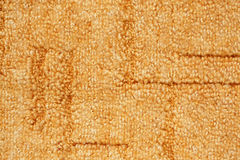 A orange carpet texture Stock Images