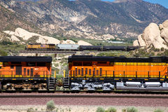 Orange carriages of a train carrying oil. Trains are transporting gasoline and large quantities Stock Photo
