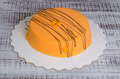 Orange carrot chocolate velour mousse cake with blueberry Stock Images