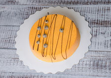 Orange carrot chocolate velour mousse cake with blueberry Stock Image