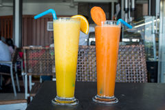 Orange and carrot fresh healthy juices Stock Photos