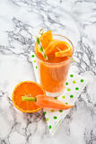Orange and carrot smoothie Royalty Free Stock Images