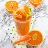 Orange and carrot smoothie Royalty Free Stock Image