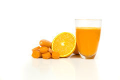 Orange and carrots juice. A glass full with orange and carrots juice in a white bbackground Stock Photography
