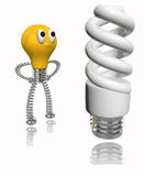 Orange cartoon bulb looking at energy saving bulb Stock Photography