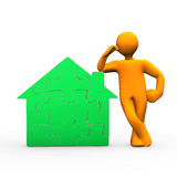 Manikin Green House. Orange cartoon character with green puzzle house Royalty Free Stock Photos