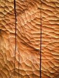 Orange carved wooden board Stock Image