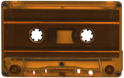 Orange cassette tape. Retro orange plastic cassette tape Royalty Free Stock Images