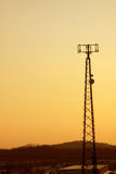 Orange Cast Cell Tower Stock Photos