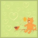 Orange cat and singing bird Stock Photos