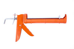 Orange Caulking Gun Stock Photography