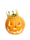 Orange caved pumpkin wears a c. An Orange caved pumpkin wears a crown against a white background Stock Image