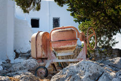 Orange cement mixer on a construction site.  Royalty Free Stock Images