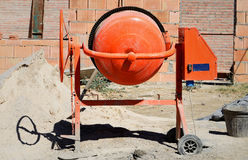 Orange cement mixer. At a construction work royalty free stock photography