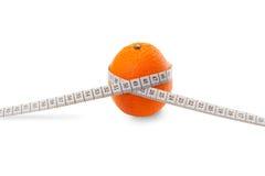 Orange with centimeter. Fresh orange on the isolated background Stock Photos