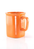 Orange ceramic cup. Royalty Free Stock Images