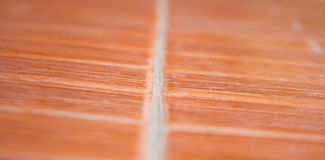 Orange ceramic tile floor. Stock Photos