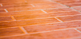 Orange ceramic tile floor. Royalty Free Stock Photos