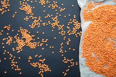 Orange cereals lentils on a black and white background. Vegetarian food, diet stock photography