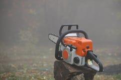 Orange chainsaw Stock Photos