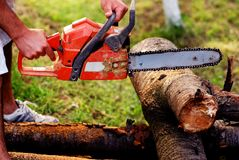 ORANGE CHAINSAW. And wood,equipment royalty free stock photos