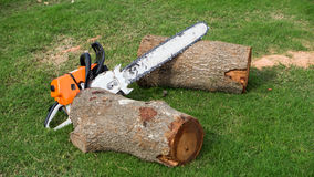 Orange chainsaw Royalty Free Stock Images