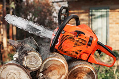 Orange chainsaw Stock Image