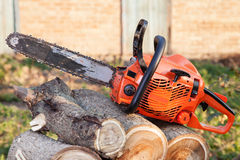 Orange chainsaw Royalty Free Stock Image