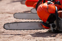 Orange chainsaw stands Stock Images