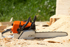 Orange chainsaw Stock Photography