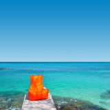 Orange chair. On wood bridge near the sea stock photos