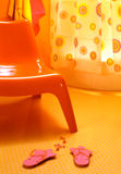 Orange chair. In the bathroom royalty free stock image