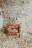 Orange Chair. In a Decayed and Empty Room stock images