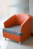 Orange chair. With gray seat royalty free stock image