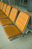 Orange chair at airport Stock Photography