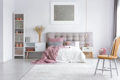 Orange chair in bright bedroom royalty free stock image