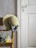Orange Chair, Hat and Old Farmhouse Door Stock Photo