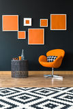 Orange chair next to table. Orange swan chair standing next to a modern table royalty free stock image