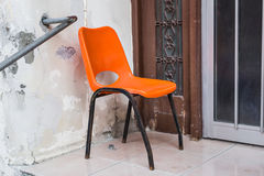 Orange chair outdoor. Design vintage furniture outdoor stock photos