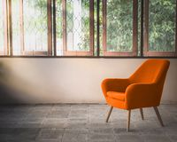 Orange chair in room. Orange chair decorated in vintage style room royalty free stock images
