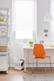 Orange chair in teen room Royalty Free Stock Image