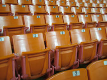 Orange Chairs. View of a lecture hall / stadium seating Stock Photo