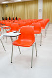 Orange chairs  in classroom Stock Photography