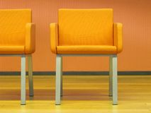 Orange chairs. Modern orange chairs interior isolated Stock Image