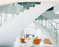 Orange Chairs Near Staircase Stock Image