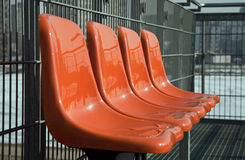 Orange chairs in a row Stock Photo